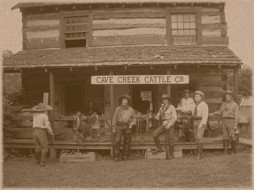 En gammal bild på en grupp cowboys.