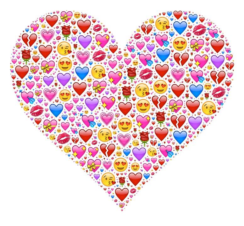 Ett hjärta som består av massor med små emojisymboler.