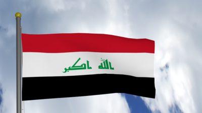 Iraks flagga med färgerna rött, vitt och svart.