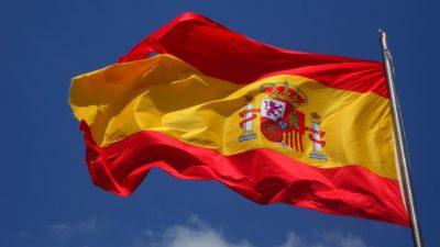 Spaniens flagga som är tre ränder, två röda och en gul i mitten. På den gula randen finns också en bild.