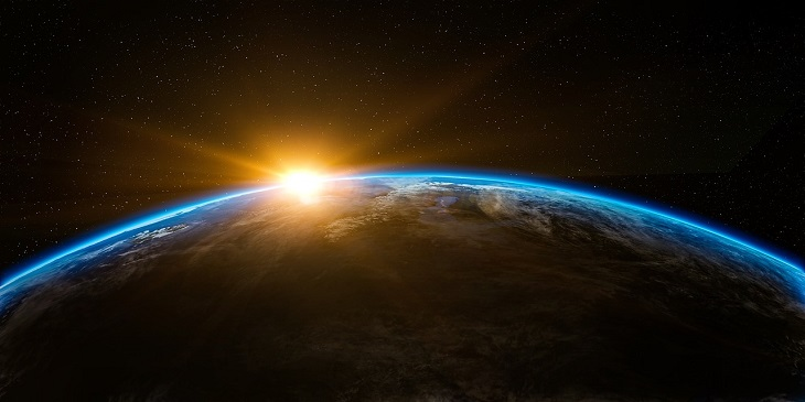Bild från rymden där len går upp över jorden