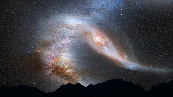Himlen, och på den syns en stor galax i form av ett bälte med punkter som lyser.