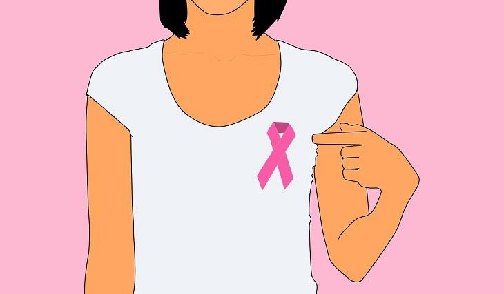 En tecknad bild på en person i vit tröja. På tröjan sitter ett rosa band som personen pekar på.
