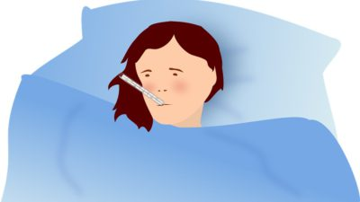 Ett sjukt barn emd termometer i munnen.