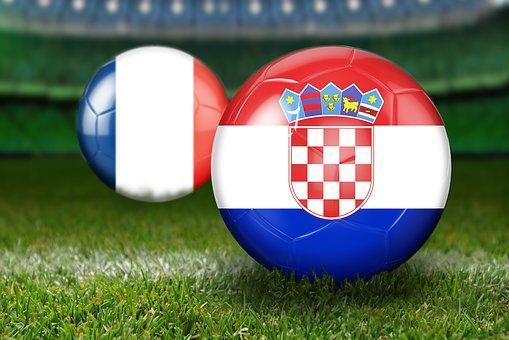 Två bollar med frankrike och kroatiens flagga på.