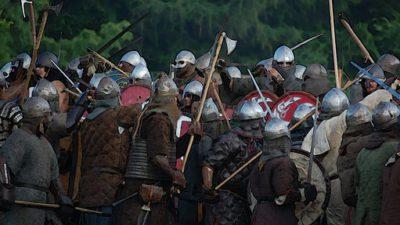 Människor utklädda till vikingar som låtsaskrigar.