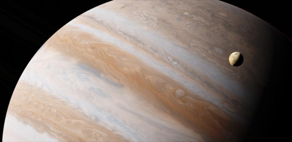 Planeten Jupiter med en måne som roterar runt den
