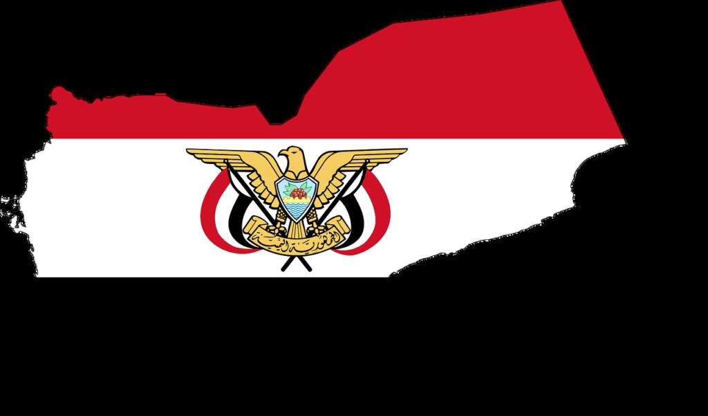 En kontur av landet Jemen. Konturen är fylld av Yemens flagga som består av tre ränder i rött, vitt och svart. På flaggan är en stor symbol med en örn.