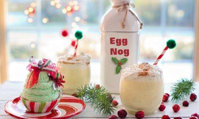 Två glas med äggtoddy och en muffin med grön glasyr.