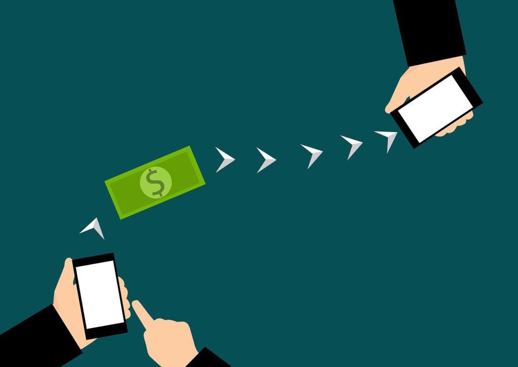 Tecknad bild på två mobiltelefoner som skickar en dollarsedel mellan varandra.