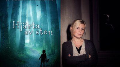 """Författaren Ingelin Angerborn står bredvid sin bok """"hjärta av sten"""""""