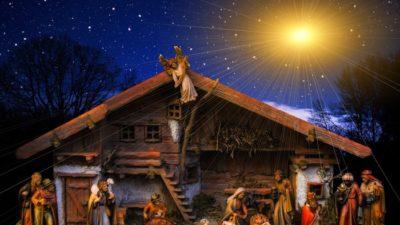 Krubba med jesusbarnet och stjärna ovanfäör som tindrar.