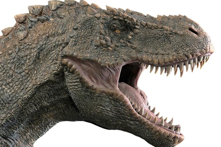 En närbild på en dinosaurie som gapar och visar alla sina vassa tänder.